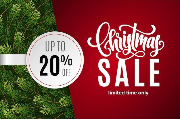 Saldi natalizi 20% di sconto con adesivo di carta con rami di abete