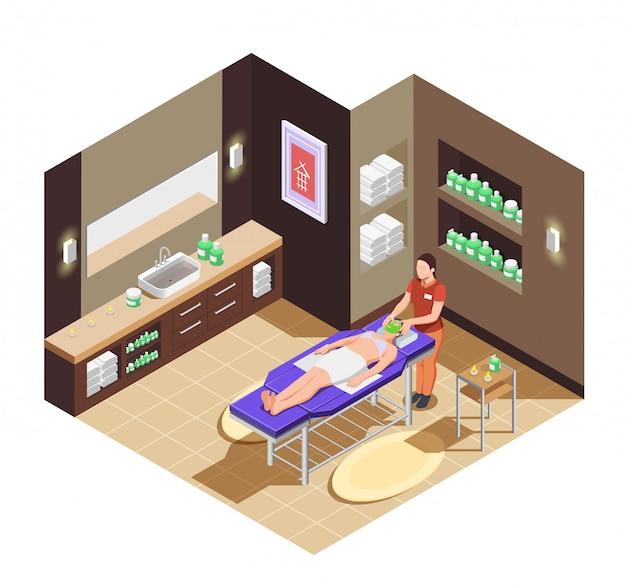 Salone di bellezza della stazione termale con la donna che riceve un massaggio