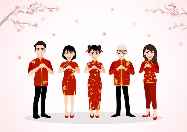 Saluto del personaggio dei cartoni animati del popolo cinese nel festival cinese del nuovo anno sugli alberi del fiore della prugna con la stagione primaverile