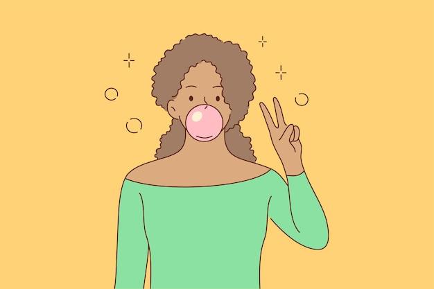 Saluto, gesto, positività, concetto di pace. giovane rilassato felice afroamericano donna ragazza personaggio dei fumetti masticare gomma da masticare mostrando due dita segno pacifico