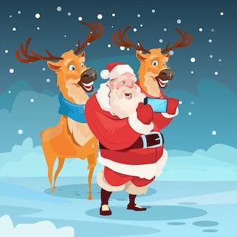 Santa claus with reindeer making selfie foto
