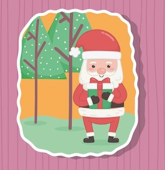 Santa sveglia con il regalo e gli alberi buon natale