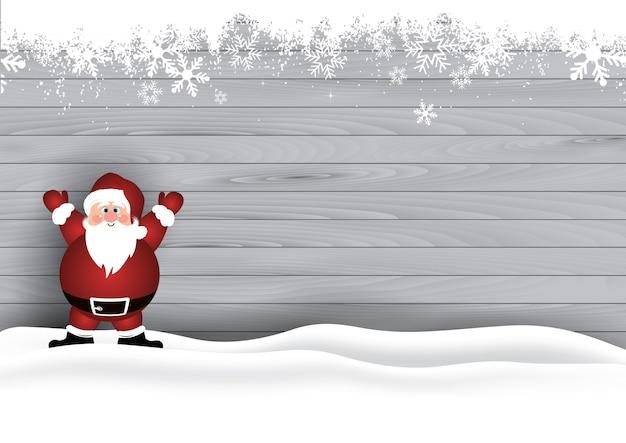 Santa sveglia nella neve su un fondo di legno di struttura