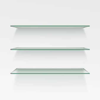 Scaffali di vetro vuoti sullo sfondo della parete