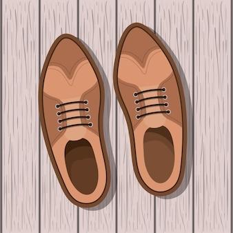 Scarpa maschile su fondo in legno