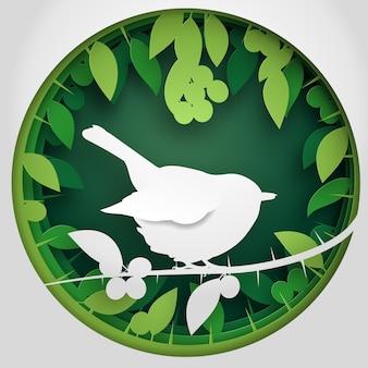 Scatola di carta di ombra all'uccello sul ramo di albero del prugnolo