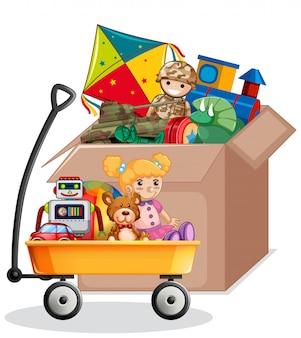 Scatola di cartone in pieno di giocattoli isolati