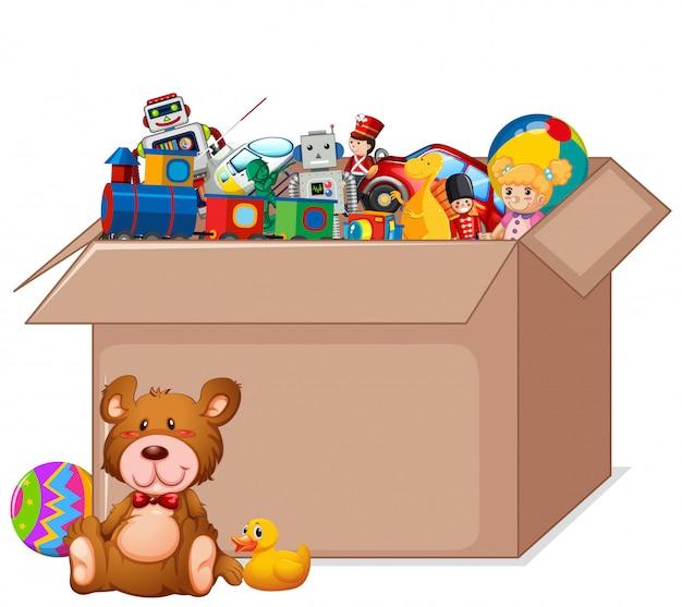 Scatola di cartone piena di giocattoli su bianco