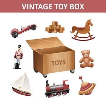 Scatola di giocattoli vintage con treno a dondolo e nave