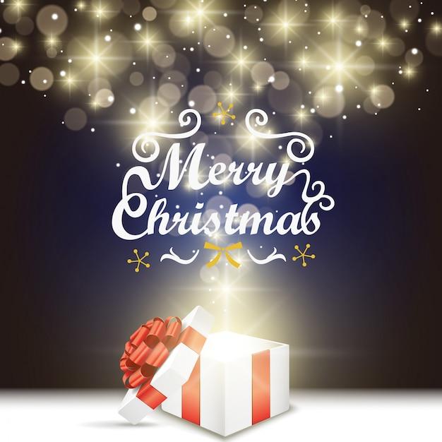 Scatola regalo aperta con fiocco rosso e luci dorate