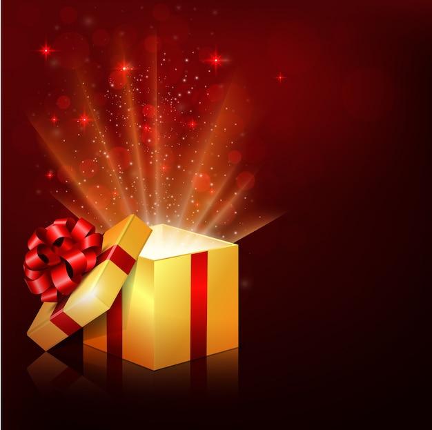 Scatola regalo aperta con raggi luminosi luminosi