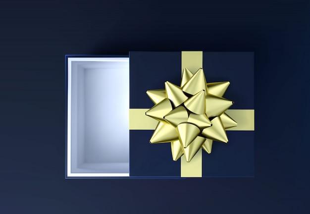Scatola regalo nera con fiocco dorato vista dall'alto.