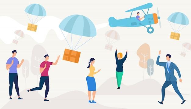 Scatole che cadono giù con paracadute dall'aeroplano