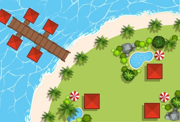 Scena aerea di capanne e spiaggia
