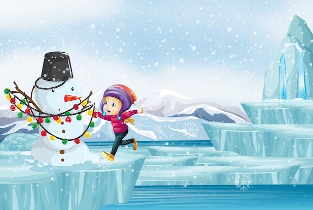 Scena con bambino e pupazzo di neve sul ghiaccio