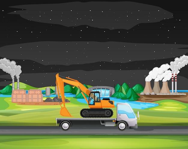 Scena con camion che guida lungo la zona industriale