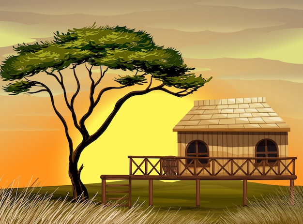 Scena con capanna di legno nel campo