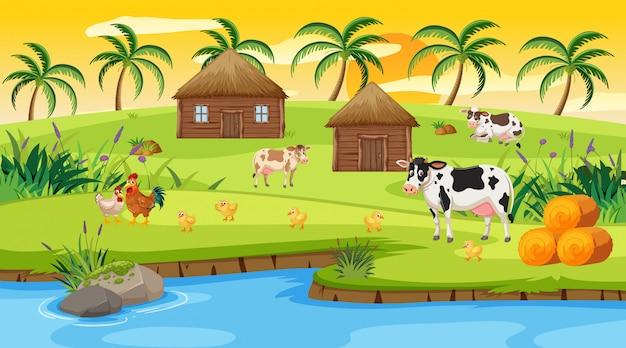 Scena con case e molti animali da fattoria sulla collina