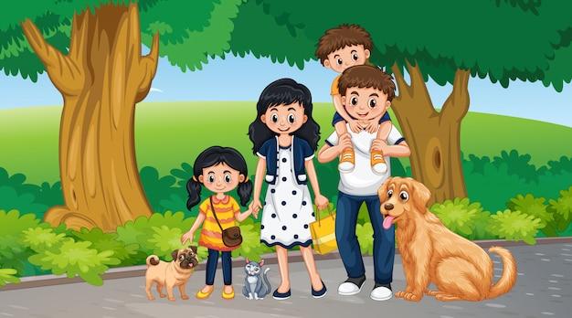 Scena con famiglia e animali nel parco