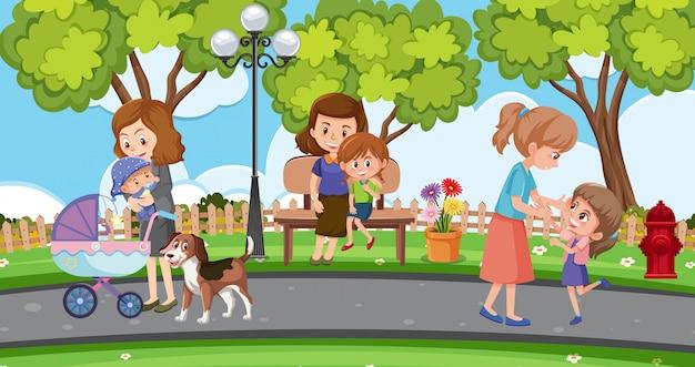 Scena con madri e bambini che si rilassano nel parco