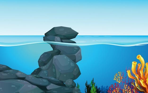 Scena con rocce sotto l'oceano