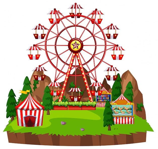 Scena con ruota panoramica e giochi circensi nel parco