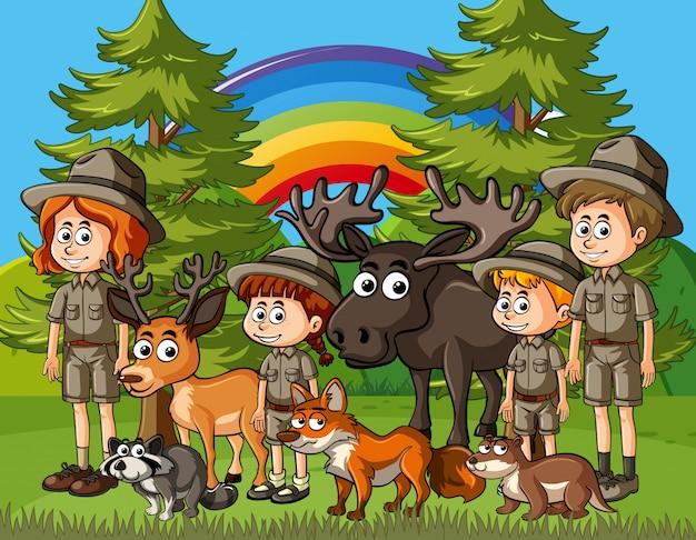 Scena con zookeepers e molti animali selvatici nel parco