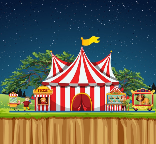 Scena del circo con tenda e leone in gabbia