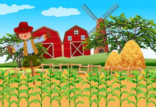 Scena dell'azienda agricola con colture e spaventapasseri