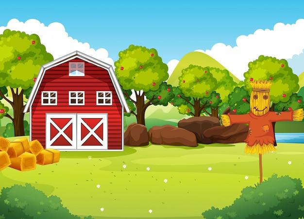 Scena dell'azienda agricola in natura con fienile e spaventapasseri