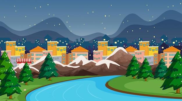 Scena della città con fiume e neve