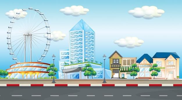 Scena della città con la ruota panoramica e le costruzioni