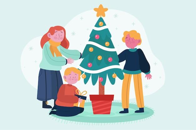 Scena della famiglia di natale con l'albero