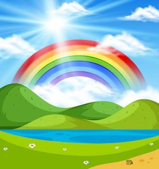 Scena della natura con arcobaleno sulle colline
