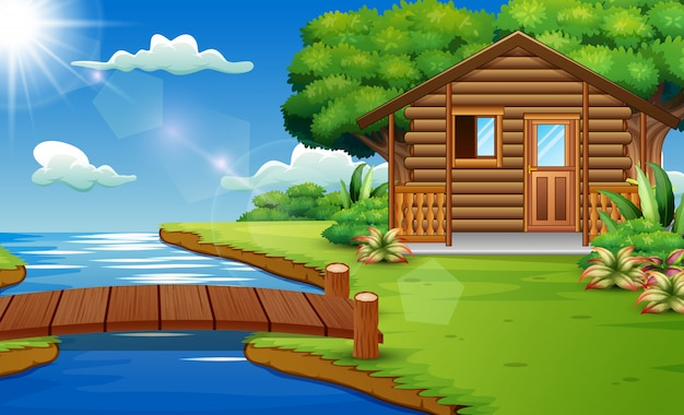 Scena della natura con case di legno sul bordo del fiume