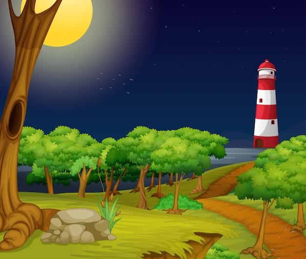 Scena della natura con il faro di notte
