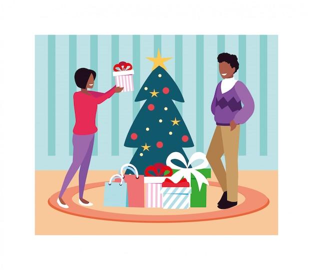 Scena delle coppie con l'albero di natale e il regalo