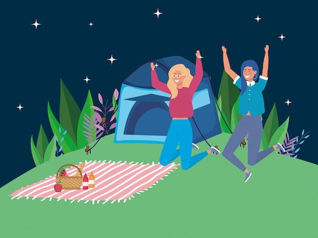 Scena di campeggio di notte di picnic della coperta della tenda delle donne di salto