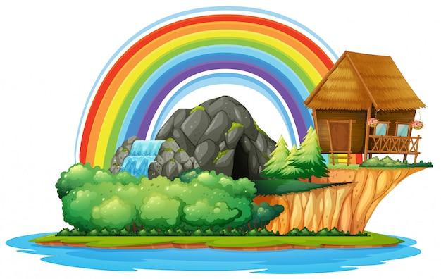 Scena di sfondo con capanna in legno e cascata sull'isola