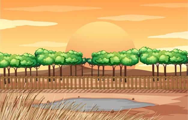 Scena di sfondo con recinzione intorno allo stagno