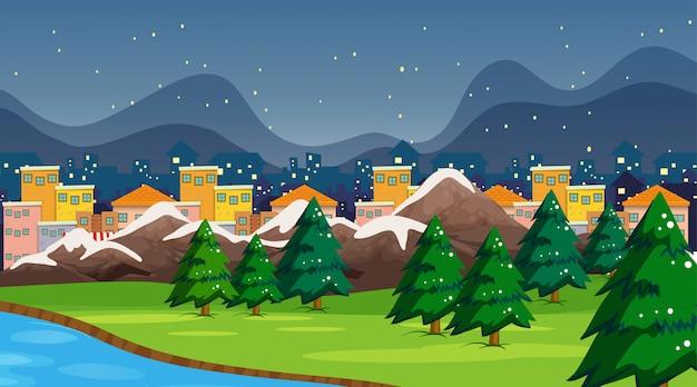 Scena e fondo della città e del parco con neve