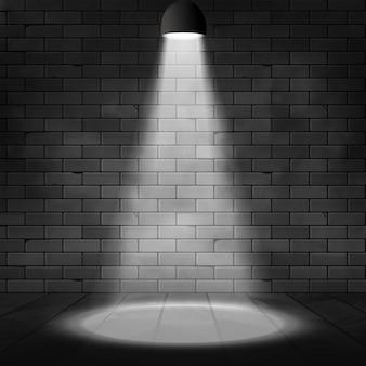 Scena illuminata dai riflettori e muro di mattoni. sfondo effetto bagliore. decorazione scenica con lampada proiettore