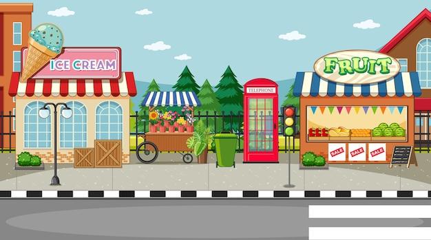 Scena lato strada con gelateria e fruttivendolo