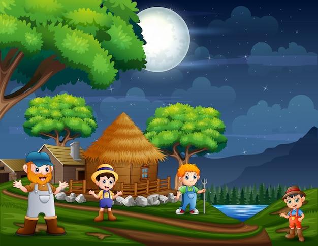 Scena notturna con gli agricoltori a terreni agricoli
