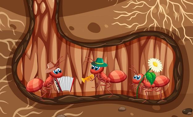 Scena sotterranea con formiche che suonano musica