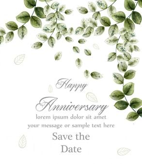 Scheda di anniversario felice con foglie verdi dell'acquerello