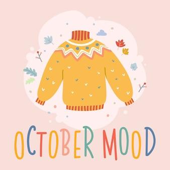 Scheda di autunno con l'iscrizione e l'illustrazione del maglione