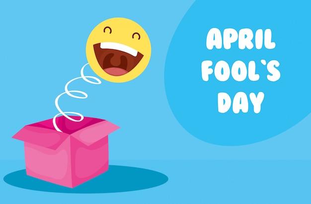 Scheda di giorno di pesci d'aprile felice con scatola a sorpresa ed emoji