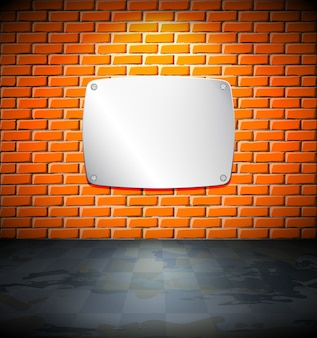 Schermo metallico sul muro di mattoni