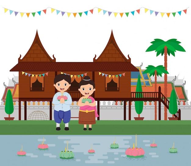 Scherza l'abbigliamento tradizionale con il festival del kratong della tailandia di loy